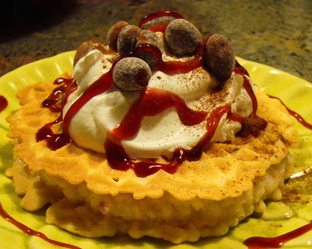 Coconut Toffee Pizzelle with Raspberry Sauce by norwichnuts