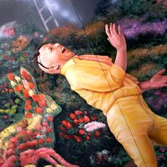 JR strangeland 3 (troutfactory) Tags: flowers rabbit strange yellow japan digital square weird jr drugs   osaka hallucination nightmare kansai ricoh jumpsuit frightening  whiterabbit hallucinogenic osakastation harrowing hallucinatory  squaure grd2 onepillwillmakeyousmaller