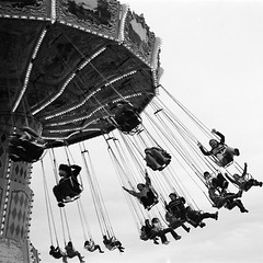 scenes from the fair: wave swinger (aye_shamus) Tags: blackandwhite bw canon nc ride kodak tmax iso400 northcarolina rides tmax400 kodaktmax400 tmaxdev ncstatefair canonetgiiiql17 fairride vuescan classicblackwhite canoscan8800f