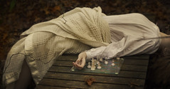 Check (Rebecca Williams.) Tags: bridge autumn selfportrait glass girl leaves forest check hand stuck chess explore whiteshirt chessset whiteblanket curledfingeres