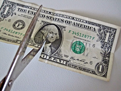 $1 bill Cut by Scissors