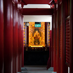Buddhist temple corridor and exit sign, Singapore.