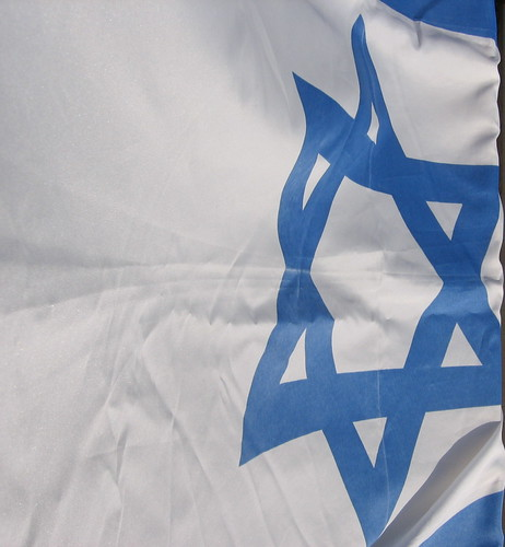 the Israeli flag flapping in the wind
