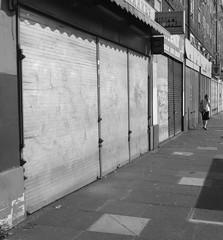 Kennington Park Road (--Sam--) Tags: street uk urban blackandwhite london monochrome urbandecay shutters boardedup oval lambeth kennington se11 kenningtonparkroad