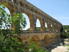 The Pont du Gard Roman Aqueduct (mike_smith's_flickr) Tags: bridge holiday france monument mediterranean worldheritagesite viaduct aqueduct provence pontdugard southoffrance aquaduct pyrenees romans camargue romanbridge oldbridge gardon romanaqueduct ancientbridge 2000yearold romanbuilt romanbuilding rivergardon siteofspecialinterest pontdugardaqueduct whatdidtheromansdoforus