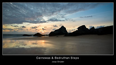 Carnewas & Bedruthan Steps (Joop Snijder) Tags: uk sunset england sky cliff reflection silhouette landscape evening coast sand rocks cornwall tide dramatic landmark panoramic shore coastline watersedge lowtide nationaltrust atlanticocean cloudscape bedruthansteps carnewas horizonoverwater