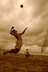 Beach Volley ([Naro]) Tags: sky cloud beach sepia fun smash jump sand pentax cloudy attack sable ciel volleyball nuage nuages filet plage volley saut trouville attaque nuageux k200 k200d