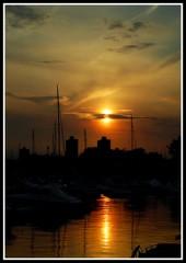 sunset (aNeg) Tags: sunset sea sky sun inspiration chicago reflection silhouette clouds boats nikon d40 goldenphotographer goldstaraward inspiredbyhim