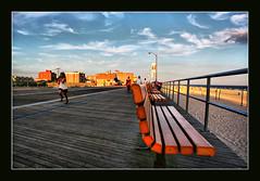 The long boardwalk at Long Beach, Long Island (DP|Photography) Tags: sunset newyork clouds bench longisland longbeach boardwalk soe seabeach supershot platinumphoto goldstaraward debashispradhan dpphotography beachesinnewyork dp|photography