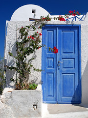 Blue door (MarcelGermain) Tags: door travel flowers blue summer vacation sky white plant beautiful architecture geotagged island greek puerta nikon holidays europe mediterranean european aegean bougainvillea santorini greece ia porta porte simple ea oia cyclades cycladic   d80 marcelgermain