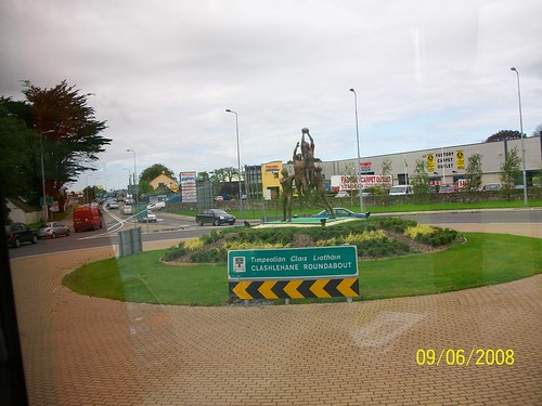 Ireland - on the road from Adare to Tralee - roundabout with sports scuplture