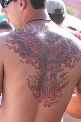 Dancing · Tribal Shoulders · Phoenix Rising from the Flames · Mask Tattoo