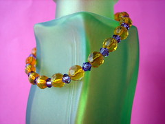 Purple and yellow bracelet (by glamourfae)