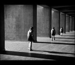 Echo... (mcazadi) Tags: light shadow people bw white black walking nikon patterns echo overlapped blackwhitephotos d700 masterpiecesoflightdark