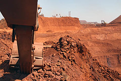 Excavators in an iron ore Mine (sanmang610) Tags: india industry horizontal bench landscape rocks iron mine industrial machine mining hills machinery mines machines shovel benches karnataka ore excavator bellary equipments haematite