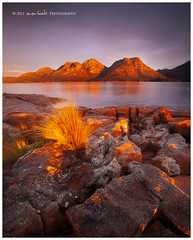 Hazardous Weather (Dylan Toh) Tags: sunset red cloud reflection grass rain rock landscape photography glow australia tasmania dee tassie hazards freycinet colesbay everlook