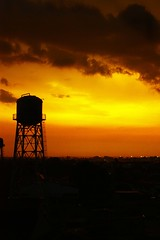 Laconic (Dyan Rioja) Tags: above city houses roof sunset sky orange sun water yellow gardens clouds buildings fire dawn lights golden afternoon dragon tank view floor vibrant philippines sunday structure line manila beyond raya condominium 6th teampilipinas