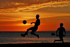 Football in sunset (jendayee) Tags: friends sunset sea orange beach warm martinique oneofakind breathtaking aclass goldenglobe catchycolorsred catchycolorsorange sunsettime flickrcolour theloveshack diamondheart platinumphoto iltramonto diamondclassphotographer megashot picturingmen aphotos colorvisions exemplaryshots diamondstars flickrsun platinumheartaward imagesdefrance allfromatoz naturessilhouettes dazzlingshots theperfectphotographer goldstaraward justbeauty goldenphoto photosexplore dragongoldaward yourpreferredpicture highqualityimages digiphotopro explorewinnersoftheworld 469photographer bellesprisesdevues flickrlovers expressionphotographic themostfaved colorphotoawardgold iqimagequality sunsetsofourheart artinoneshot photographerswarf ballonaward beautifulshotawards