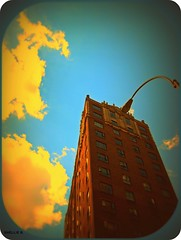 sharply angled retro (ziggywiggy1(SHELLIE B.)) Tags: nyc color art yellow clouds photomanipulation buildings experimental manhattan bluesky sensational breathtaking dreamimages abigfave altereduniverse royalgroup onlythebestare photostosmileabout thepsychedeliccolourgroup digitaleloquence photographersgonewild