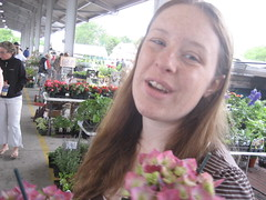 Amelia with flowers (EMFPhoto) Tags: rochester amelia publicmarket