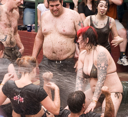Tattoo is girl is mud bath