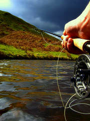 Pulling..... (Nicolas Valentin) Tags: light mountain lake nature scotland fishing bravo hill lambs flyfishing loch wilderness supershot aplusphoto hillloch