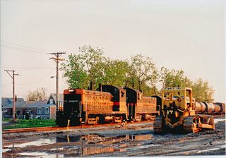 Rare photo! Eastbound Indiana Harbor Belt t switching train approaching South Lawndale Avenue near West 49th Street. Chicago Illinois. May 1990.