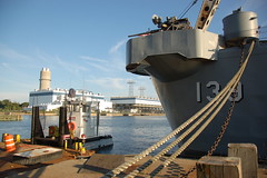 "USS Salem park: stern of the cruiser, plus miniature tugboat tender (??) with ""UNDERDOG"" logo on cabin (Chris Devers) Tags: ocean bridge sea water sign museum architecture river logo ma quincy boat ship unitedstates massachusetts navy vessel maritime vehicle drawbridge salem nautical naval 2008 usnavy weymouth cruiser uss warship coldwar liftbridge shipbuilding quincyma foreriver usssalem heavycruiser foreriverbridge ca139 cameranikond50 forerivershipyard weymouthma exif:flash=flashdidnotfire exif:exposure=0001sec11000 exif:iso_speed=200 exif:focal_length=18mm exif:aperture=f35 unitedstatesnavalshipbuildingmuseum exif:exposure_bias=06ev camera:make=nikoncorporation camera:model=nikond50 meta:exif=1257954902 exif:orientation=horizontalnormal exif:filename=dscjpg meta:exif=1350405608"