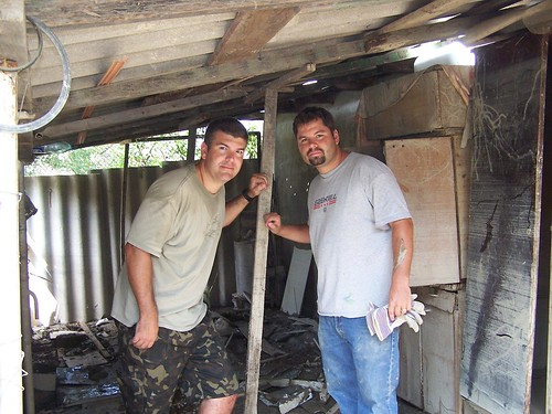 Greg and Conor after they cleaned out this shed