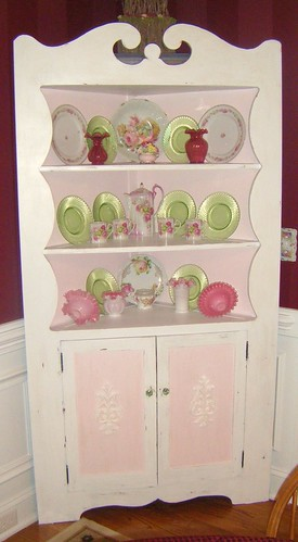 Corner French cabinet filled with green, pink and red china, via Flickr: Cottageqt