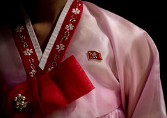 Hanbok - North Korea (Eric Lafforgue) Tags: pictures travel color colour fashion photo war asia pin dress habit picture culture pins korea kimjongil textile badge hanbok asie tradition mode couleur journalist journalists northkorea axisofevil pyongyang dictatorship  dprk coreadelnorte stalinist juche traveldestinations kimilsung nordkorea 1463 dictature lafforgue traveldestination democraticpeoplesrepublicofkorea  ericlafforgue   coredunord traditionnaldress coreadelnord  northcorea encouleur chosonot coreedunord axedumal rdpc  insidenorthkorea  rpdc   coriadonorte  kimjongun coreiadonorte