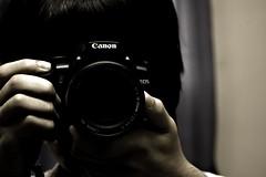 The New Gun (Waseef Akhtar) Tags: camera portrait selfportrait slr me sepia canon gun focusing canoneos400d waseef adobephotoshoplightroom