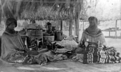 Seminole women with their hand-crank sewing machines (State Library and Archives of Florida) Tags: florida sewing seminoles nativeamerican everglades womensday chickee statelibraryandarchivesofflorida