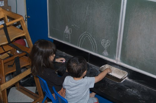 Mina and Benji playing with the chalk