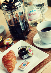 Breakfast.. (Mashael Al-Shuwayer) Tags: morning food cup water glass coffee breakfast digital canon eos 50mm strawberry butter saudi arabia evian nescafe jam saudiarabia ksa croissants alkhobar 400d mashael alshuwayer