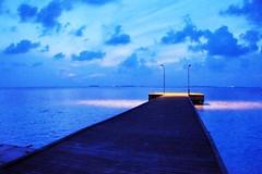 And there is light at the end?.. (nattu) Tags: blue sky holiday clouds sunrise nikon jetty maldives d90 nattu bandos kudabandos
