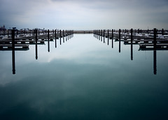 Winter Waterfront (The New No. 2) Tags: wood city blue winter sky urban usa cloud white lake chicago cold green water weather port marina dark season landscape boats coast harbor pier illinois still dock missing marine midwest closed solitude loneliness waterfront gbrearview view outdoor michigan background empty horizon shoreline windy lakemichigan pole il pile shore lakeshore pilings recreation nautical scape murky emptiness lakefront allrightsreserved breakwater copyrighted chicagoist thenewno2 closedfortheseason johncrouch collectiona copyright2008 johncrouch wwwcrouchphotoscom johncrouchphotography gettysubmitted crouchphotos