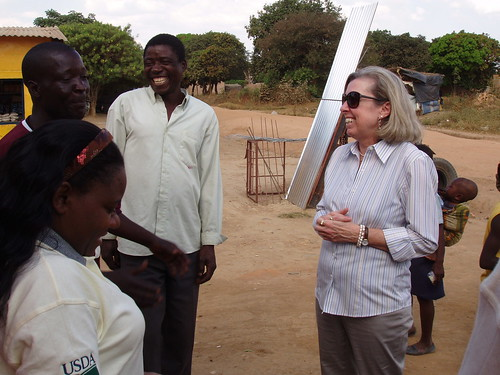 Foreign Agricultural Service Acting Administrator Suzanne Heinen (right) joins Land O'Lakes representative She Mayo (left) as they meet with local farmers at a market in Kafululu, Zambia on June 7.  At this market, Land O'Lakes monitors food prices to ensure commodity procurements and distributions do not have a disruptive impact on the market. USDA has funded a Local and Regional Procurement (LRP) Pilot Project designed to use local and regional purchasing to help improve the nutrition and quality of life of Zambian households impacted by HIV/AIDS.