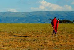 The Lone Maasai. (avp17) Tags: africa ranch 2001 red green d50 tanzania 50mm nikon daressalaam nikond50 safari ngorongoro lone farmer geology sheppard nikkor 18 50 maasai anthropology arusha masaai leakey olduvai oldupai oldupaigorge olduvaigorge
