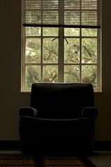 sitting in the dark on a sunny day (xgray) Tags: light shadow color window contrast digital upload canon austin dark eos prime one book lowlight chair university published alone quiet texas 85mm universityoftexas single lone iphoto blinds rug backlit rectangle rectangles subtle blurb ef85mmf18 buyit calhounhall chairbook ef85mmf18usm ordernow 40d xgray canoneos40d postedtophotographersonlj ownapieceofxgray chairsbystephenmgray
