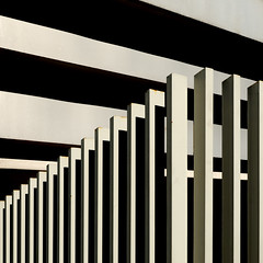 Recinzione (Fence), Roma - 2007 (Gianni Galassi) Tags: city light shadow urban blackandwhite bw abstract rome roma building architecture fence square casa blackwhite graphics nikon rust iron shadows patterns fineart ombra perspective minimal urbano minimalismo architettura bianconero biancoenero grafica quadrato ruggine prospettiva ferro metafisica 500x500 recinzione extralight ysplix giannigalassi damniwishidtakenthat winner500 goldenvisions