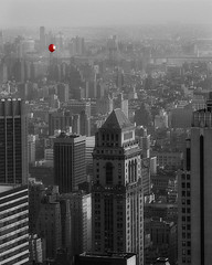 Little Red Balloon-NYC (dog ma) Tags: newyorkcity urban blackandwhite bw cityscape manhattan rockefellercenter dogma selectivecolor sigma105 nikond80 flickrchallengegroup flickrchallengewinner photofaceoffwinner photofaceoffplatinum littleredballoon pfogold