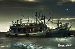 Traditional Fishing Boats ( DocBudie) Tags: photoshop indonesia ir explore infrared gettyimages medan darksky belawan fishership flickrsbest abigfave goldmedalwinner platinumphoto anawesomeshot colorphotoaward superaplus aplusphoto betterthangood woodship goldstaraward kapalnelayan multimegashot photoartbloggroup traditionalfishership