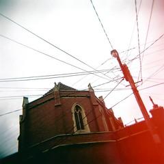 Asterisk (sonofwalrus) Tags: building film church window jack holga lomo lomography melbourne scan lightleak powerlines kensington lightpole holyrosary hpc5380