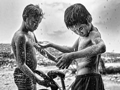 Steung Meanchey, Phnom Penh - Day 1's downpour! (con't) (Mio Cade) Tags: boy cold wet water rain season children fun shower kid cambodia child sau enjoy raining phnom penh steung meanchey rombren