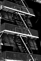 New York City - Home of the Repeating Patterns (kevin dooley) Tags: new york city nyc newyorkcity light shadow urban bw favorite ny newyork black building architecture stairs wow photography photo interesting fantastic flickr angle ltr image very good geometry manhattan patterns awesome picture free award superior rail pic super best line diagonal more most photograph creativecommons wi