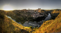 toledo sunset panorama (mariusz kluzniak) Tags: old city sunset panorama sun yellow river town spain europe sony historic toledo rays alpha espania 580 a50 autostich the4elements