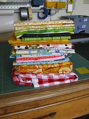 stack of fabric from the shop hop