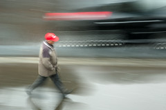 Rushing (ubiquity_zh) Tags: red rain switzerland zurich pedestrian cap rush zrich zuerich rushing frommybalcony