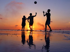 shades - children of life (i b u) Tags: life blue sunset orange sun playing male nature kids clouds canon ball reflections children bravo skies joy silhouettes shades local splash maldives geo maale twtme ibrahimmohd ibumohd maldivesibusadventure geomaldives